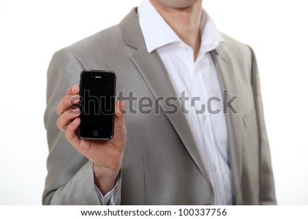 Man showing Smartphone - stock photo