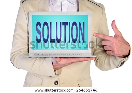 man showing solution word on laptop - stock photo
