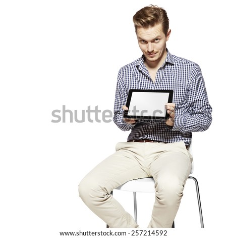 Man showing something on the digital tablet. Copy space.  - stock photo