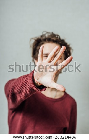 man shows stop gesture