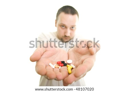 man shows the hands full of pills - stock photo