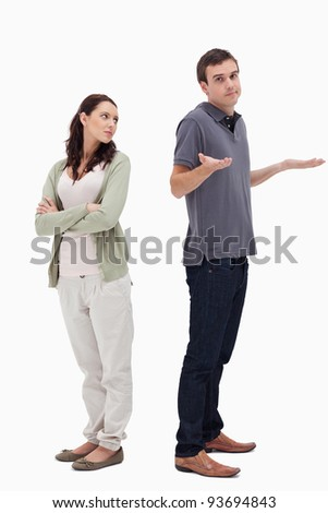 Man shrugged his shoulders back to back with woman against white background - stock photo