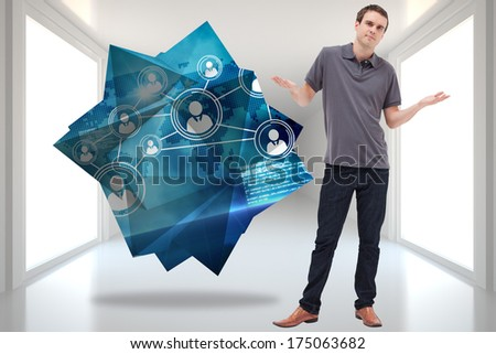 Man shrugging his shoulders against bright hall with windows - stock photo