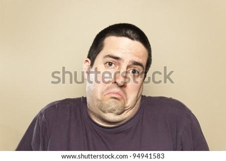 Man shrugs - stock photo