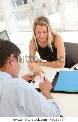 man signing car rental contract