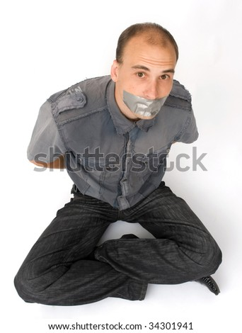 man silenced with duct tape over his mouth - stock photo