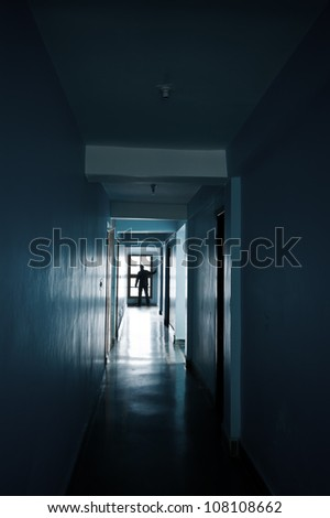 Man silhouette in end of corridor - stock photo