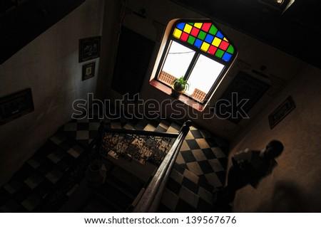 Man silhouette on a dark Colonial staircase in Stonecity, Zanzibar - stock photo