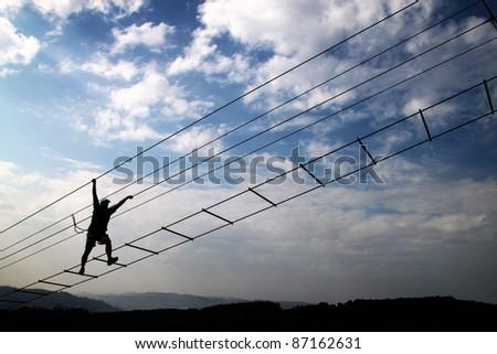 Man silhouette on radical bridge - stock photo