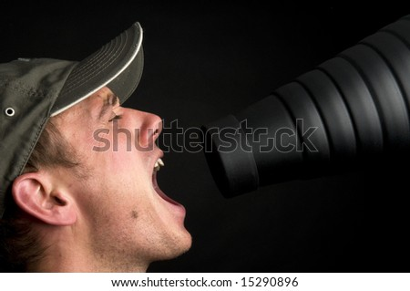Man singing in front of a snoot, against a black background. - stock photo