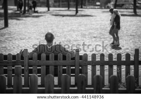 Man sits on a bench back in the city