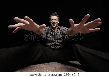 Man sitting a reaching out his hands