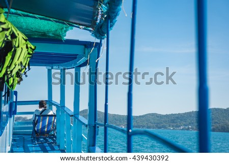 Man sitting alone on a camp bed on the ferry boat. Selective Focus. - stock photo