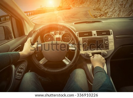 Man sitting and driving in the car. - stock photo