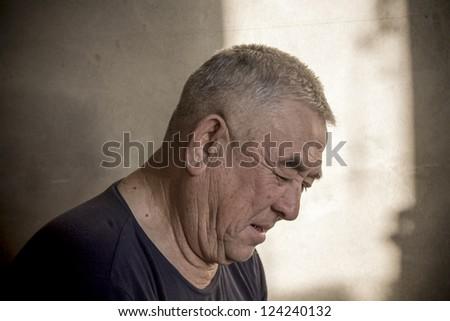 man sitting and watching - stock photo