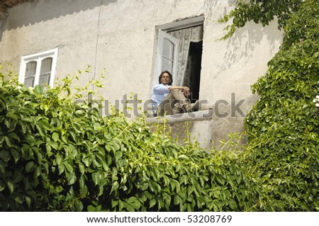 Man sitting at a window - stock photo