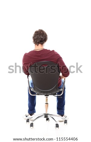 Man sitting in a chair with his back to camera over white background - stock photo