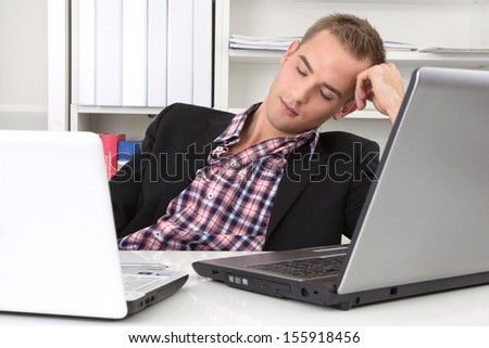 Man sitting in office resting