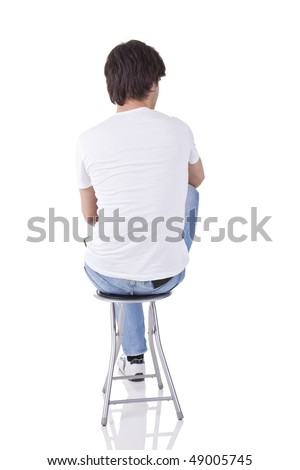 man sitting on a bench in back - stock photo