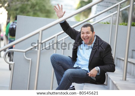 Man sitting on a staircase and waving