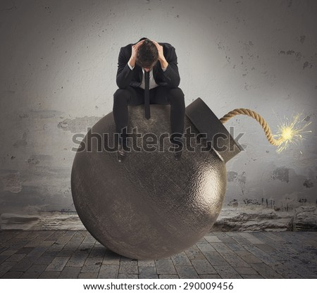 Man sitting on bomb expected to explode - stock photo