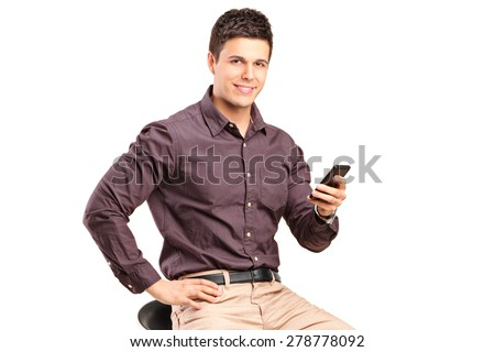 Man sitting on chair and holding mobile phone isolated on white background
