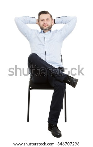 man sitting on chair. Isolated white background. Body language. gesture. Training managers. sales agents.  laying hands behind his head. the foot on the leg