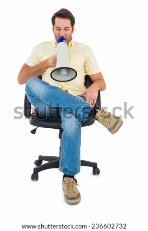 Man sitting on chair shouting through megaphone on white background - stock photo