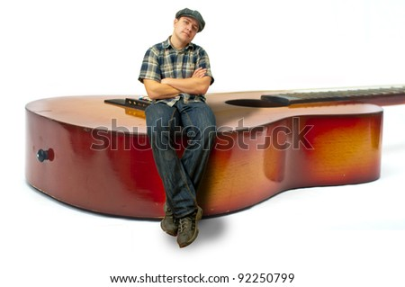 man sitting on guitar