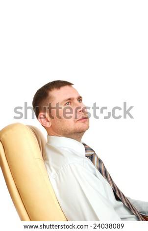 man sitting on the armchair - stock photo