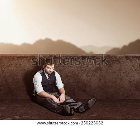 Man sitting on the floor - stock photo