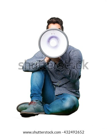 man sitting on the floor holding a megaphone