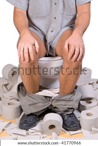 man sitting on the toilet - stock photo