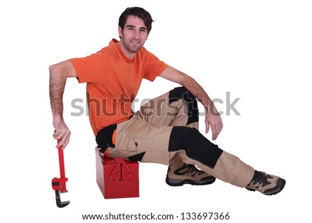 Man sitting on toolbox