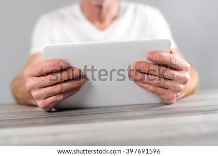 Man sitting using a tablet