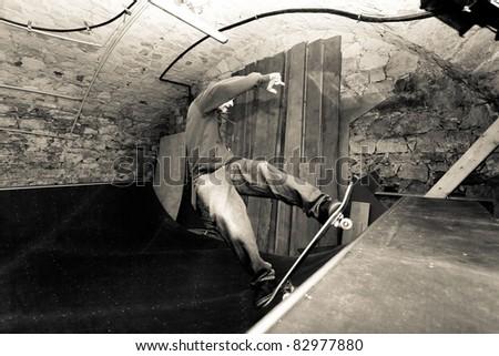 Man skating a half pipe - stock photo