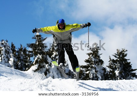 Man ski jump over snow hill. Winter season sports concept