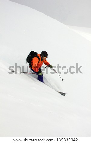 Man skiing down a steep slope in the Utah mountains, USA., - stock photo