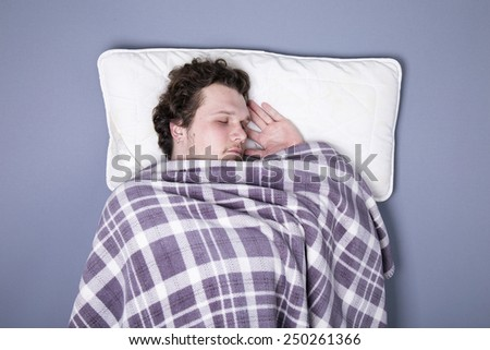 man sleeping in bed - stock photo