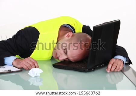 Man sleeping on his laptop - stock photo