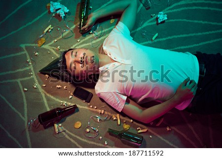 Man sleeping on the floor after party - stock photo