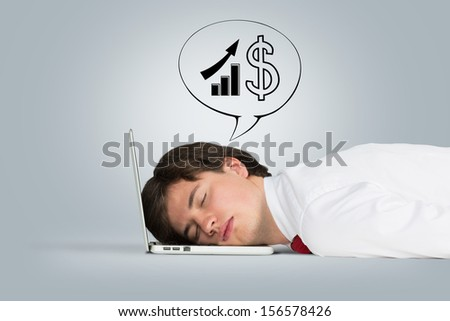 man sleeping on the laptop and dreams of career growth