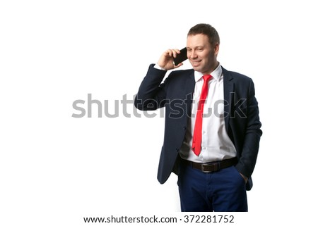 man smiling and talking on the phone
