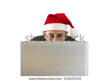 man smiling at the websites for travel deals on Christmas - stock photo