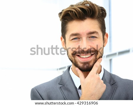 Man smiling in the office - stock photo