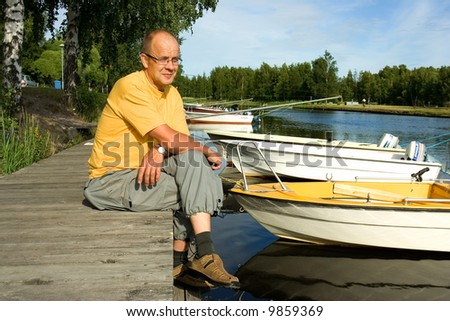 Man smiling on a pier