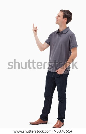Man smiling while standing and presenting something above against white background - stock photo