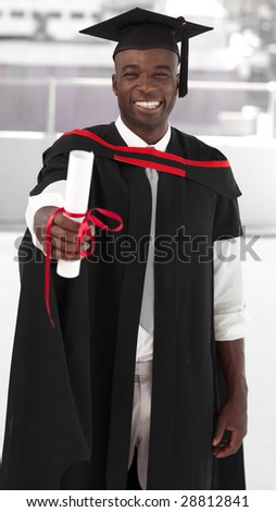 Man smilling at university graduation celebration - stock photo