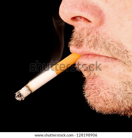 Man Smoking a Cigarette in close up - stock photo