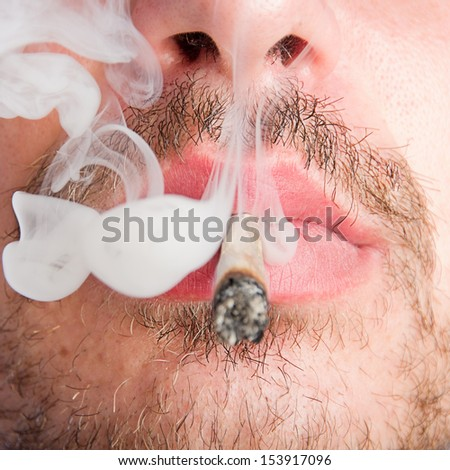 man smoking a joint - stock photo